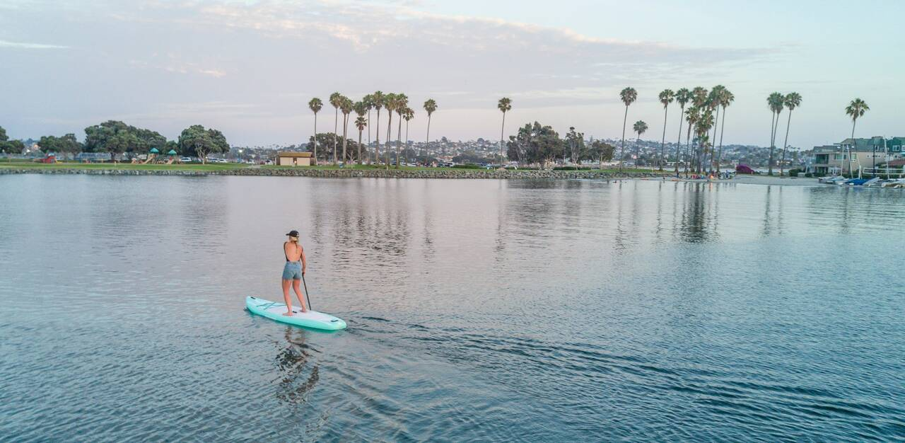 Riding a Tower inflatable paddle board in the bay.  - Wasserski Bleibtreusee